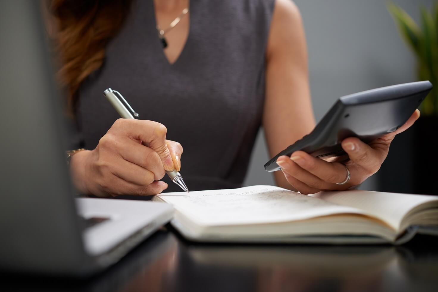 business woman taking care of bookkeeping for a small business